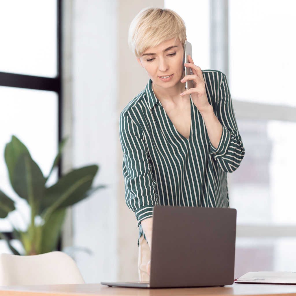 businesswoman-talking-on-cellphone-standing-near-w-9V4TAUN.jpg