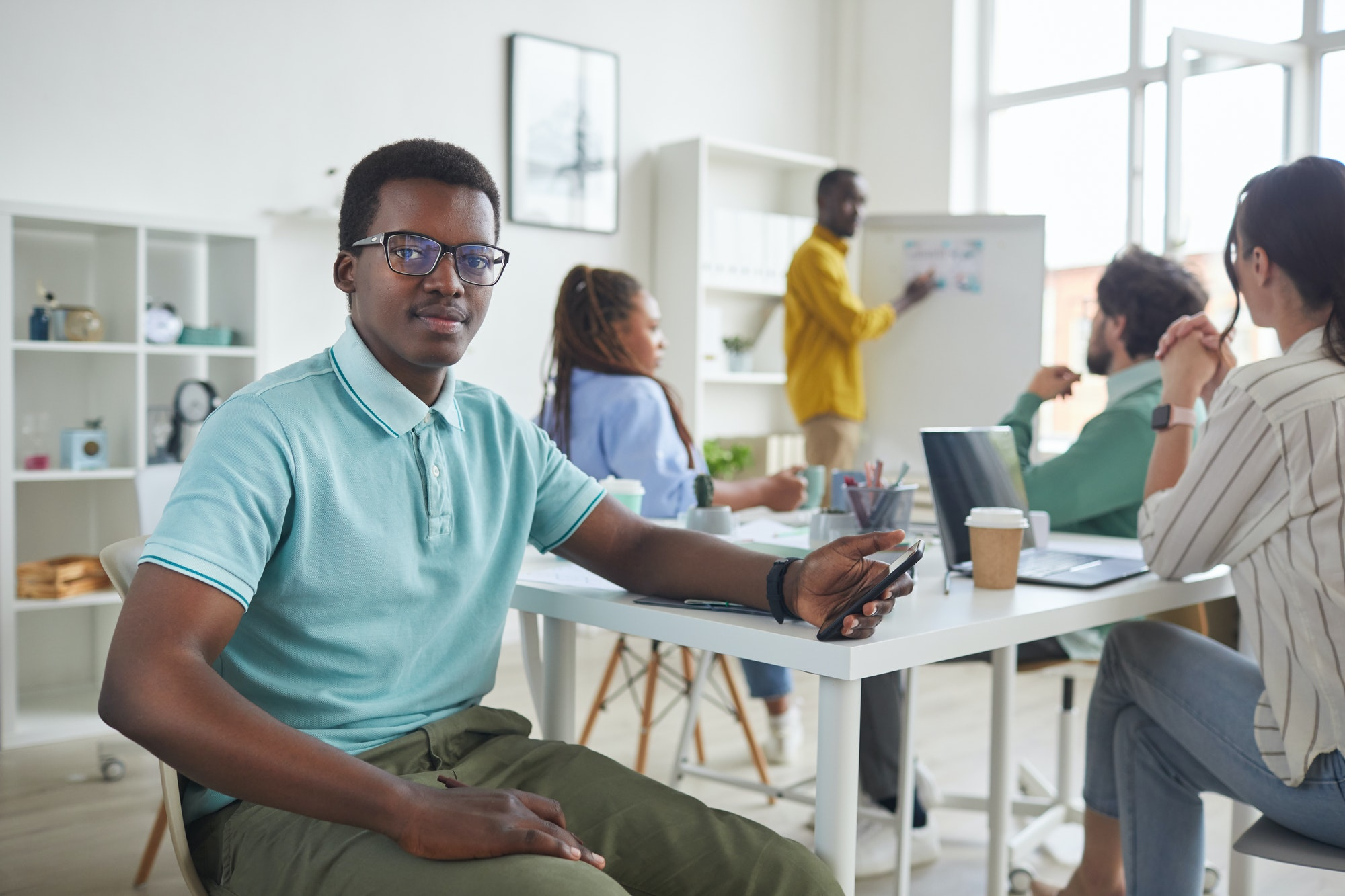 Young African-American Intern in Meeting